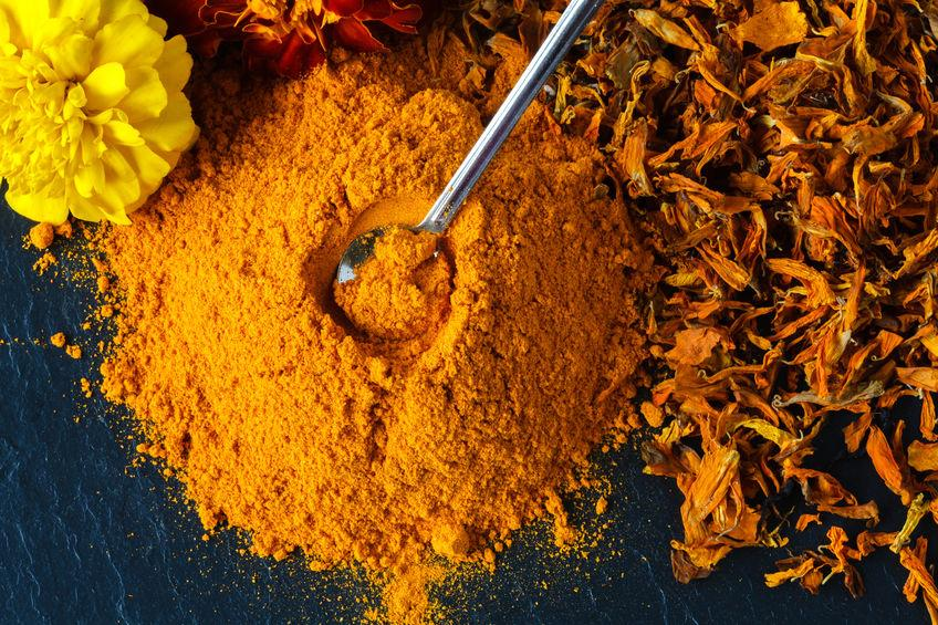 Turmeric powder over slate background